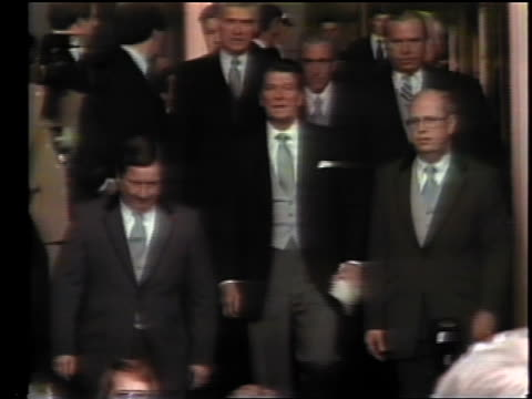 vídeos de stock e filmes b-roll de january 20, 1981 ronald reagan walking in group exiting building for inauguration - 1981