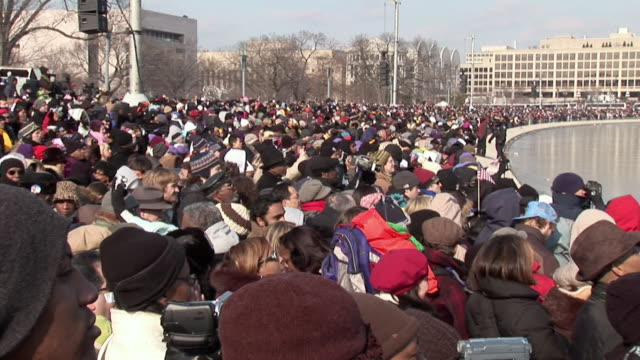 january 20, 2009 montage crowd listening to barack obama's inaugural address on the national mall / washington dc / audio - 2009 stock videos & royalty-free footage