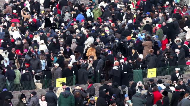 january 20 2009 people arriving and finding seats at the inauguration of president barack obama/ washington dc/ audio - 2009年点の映像素材/bロール