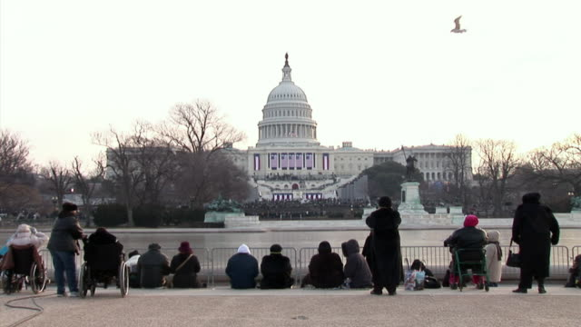 january 20 2009 ws spectators in front of the capitol building at the inauguration of barack obama / washington dc / audio - 2009 video stock e b–roll