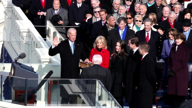 january 20 2009 ms vice president joe biden being sworn into office by chief justice john paul stevens as biden's wife jill and sons beau and hunter... - 2009 video stock e b–roll