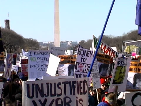stockvideo's en b-roll-footage met january 2003 high angle wide shot signs at anti-war protest/ washington dc - 2003