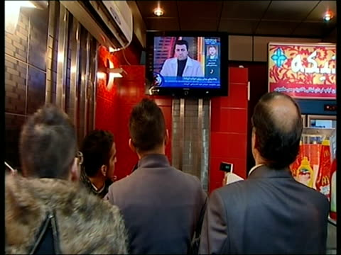 January 2009 MONTAGE MS ZO People watching Barack Obama's presidential inauguration on television/ MS Main state news channel showing reports from...