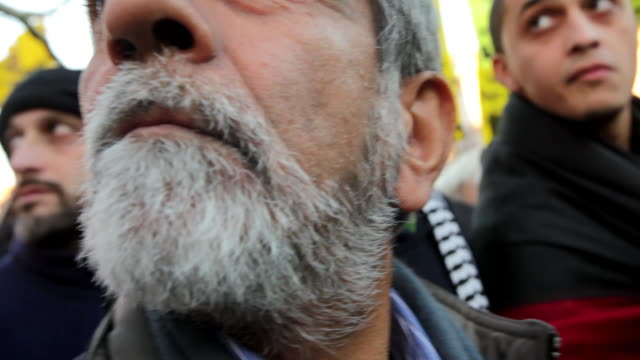 January 23 2009 Men listening to speaker during protest against Israel's attack on Gaza Strip/ Men turning and looking/ Bearded man walking away/...