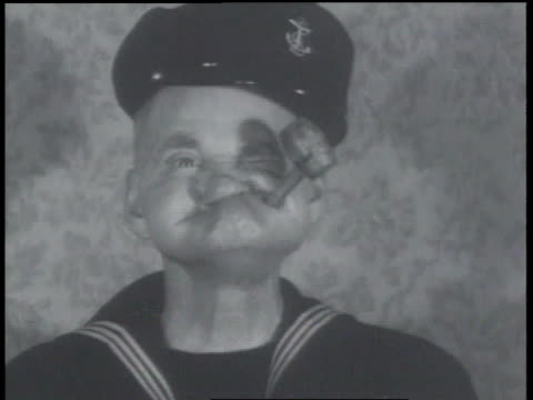 january 24, 1934 b/w man imitating popeye - matrose stock-videos und b-roll-filmmaterial