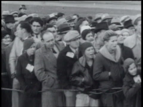 january 24, 1934 b/w spectators watching athletes skiing down slope / spokane, washington, united states - 1934 stock-videos und b-roll-filmmaterial