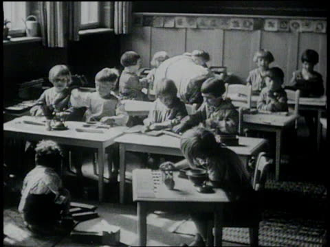 january 26, 1931 montage children in classroom playing with shapes / berlin, germany - 1931 stock videos & royalty-free footage