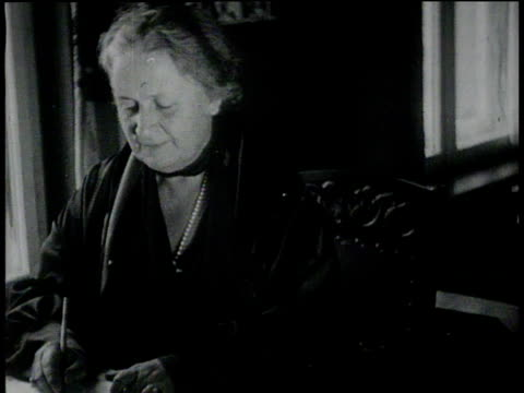 January 26, 1931 MONTAGE Dr. Maria Montessori writing at desk / Berlin, Germany