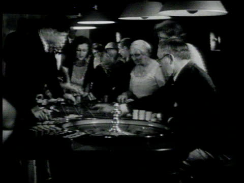january 26, 1931 montage people gambling at roulette table / st. petersburg, florida - roulette stock videos & royalty-free footage