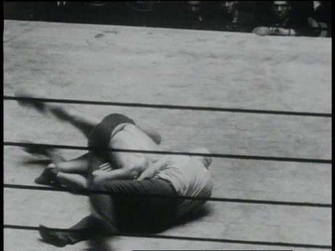 January 26, 1931 HA wrestler pinning opponent to the ground / New York, United States