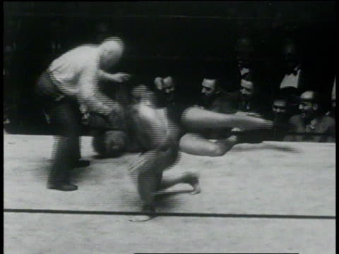 January 26, 1931 HA wrestlers fighting and rolling out of ring / New York, United States