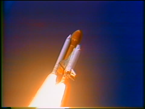 january 28, 1986 space shuttle challenger rising with flames pouring out of rockets after blast-off - 1986 stock videos & royalty-free footage