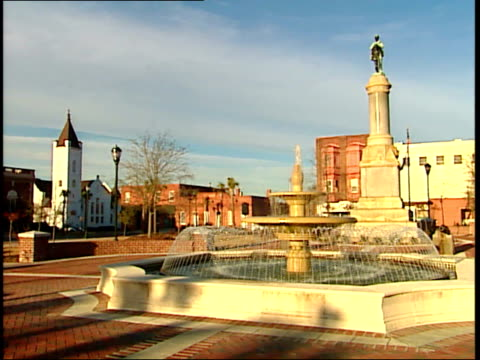 january 29, 2004 montage a fountain, statue, and sign at a monument honoring the confederate dead in orangeburg, south carolina / united states - 飾り板点の映像素材/bロール