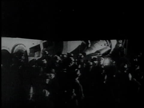 january 30 1934 montage police escorting john dillinger from a plane through a crowd / chicago illinois united states - bankräuber stock-videos und b-roll-filmmaterial