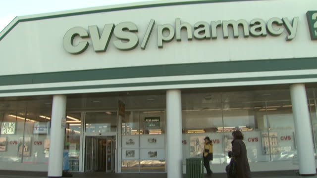 january 5, 2010 cvs pharmacy storefront with customers entering and exiting / united states - cvs caremark stock videos & royalty-free footage