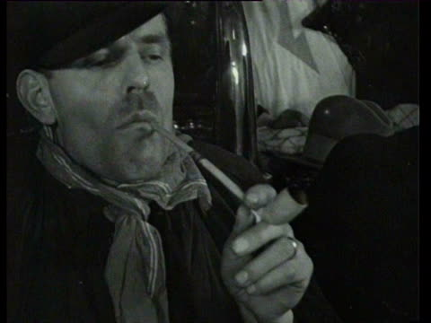 stockvideo's en b-roll-footage met january 6, 1935 b/w men hold a smoking contest, and sing a song accompanied by an accordion / oudenbosch, netherlands - 1930