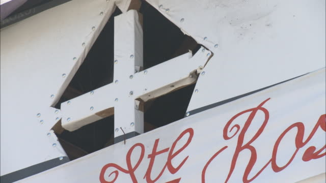 january 6 2011 la cross symbol at the top of a building / leogane haiti - hispaniola stock videos & royalty-free footage
