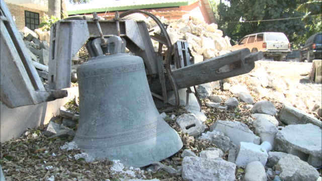 january 6 2011 montage ruined church bells laying in rubble piles next to damaged buidlings / leogane haiti - hispaniola stock videos & royalty-free footage