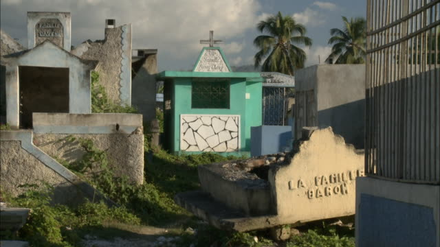 january 6 2011 montage tombs and graves disturbed and broken by earthquake and the cross at the enterance / haiti - hispaniola stock videos & royalty-free footage