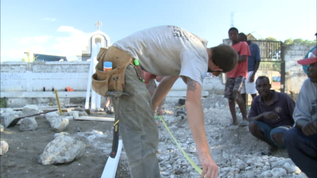 january 6 2011 td workers measuring at construction site / haiti - hispaniola stock videos & royalty-free footage