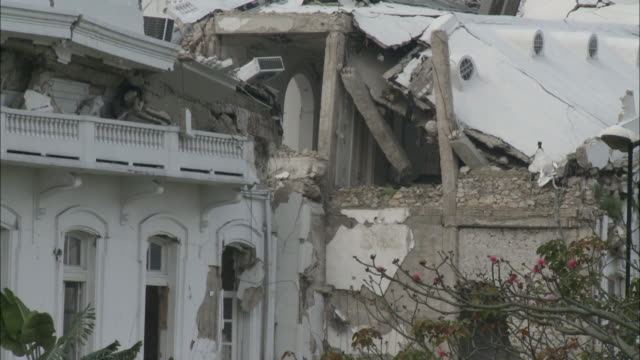 vídeos de stock, filmes e b-roll de january 7 2011 montage presidential palace destroyed by earthquake / haiti - política e governo