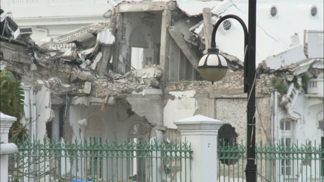 january 7, 2011 montage presidential palace in ruins from january 2010 earthquake including pedestrian and vehicle traffic along street in front /... - port au prince stock videos & royalty-free footage
