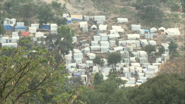 january 7 2011 zi temporary tent camp providing housing for survivors of the 2010 earthquake / portauprince haiti - emergency shelter stock videos & royalty-free footage