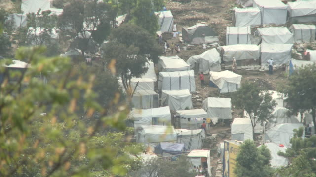 january 7 2011 ha tent city in wake of 2010 earthquake / portauprince haiti - emergency shelter stock videos & royalty-free footage
