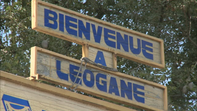 january 8 2011 la welcome to leogane sign / leogane haiti - hispaniola stock videos & royalty-free footage