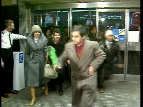 london people wait at doors of debenhams ms doors opened and shoppers run into debenhams bv people through store bv up stairs ms tara in mink coat... - sale stock videos and b-roll footage