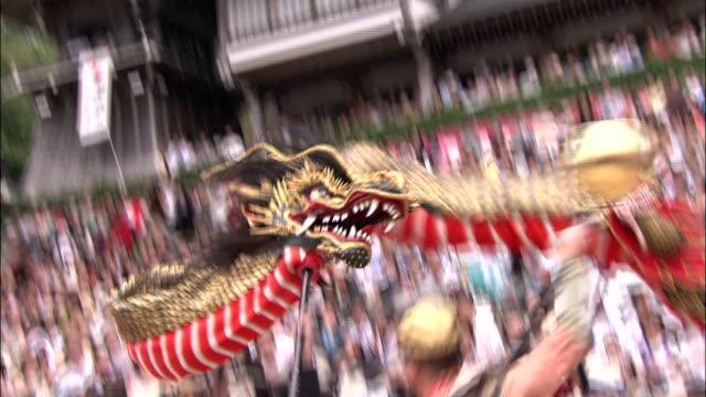 ja-odori (snake dance) at nagasaki kunchi festival, japan - 伝統行事点の映像素材/bロール