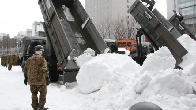 a large amount of snow is carried to odori park in sapporo hokkaido northern japan on jan 7 to create snow and ice sculptures for the feb 411 sapporo... - snow festival stock videos & royalty-free footage