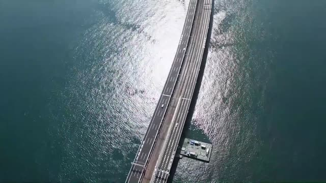 movie taken from a kyodo news helicopter on april 8 shows the bridge connecting kansai international airport on an artificial island in osaka bay... - honshu stock videos and b-roll footage