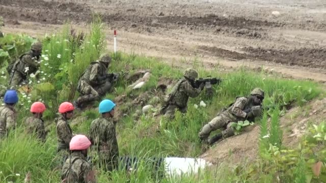 japan's ground selfdefense force conducts a joint drill with the us marine corps at an exercise area in japan's northernmost prefecture of hokkaido... - japan self defense forces stock videos and b-roll footage