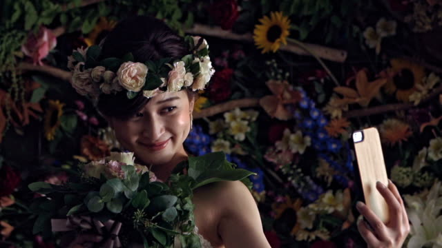 japan bride getting flowers ready for wedding - bouquet stock videos and b-roll footage