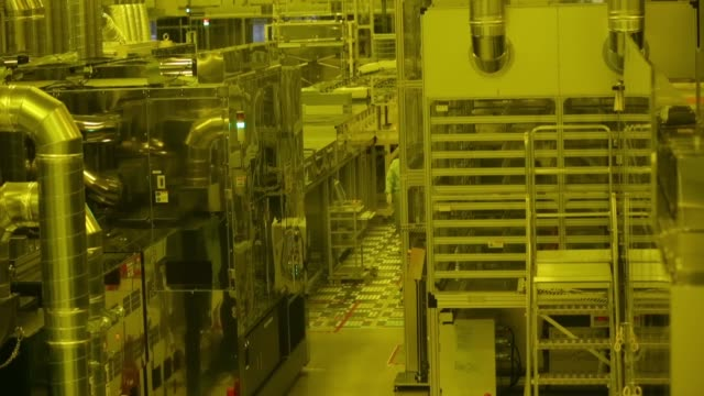 a japan display inc employee operates equipment in a clean room on the production line for the liquid crystal display lcd panels at the company plant... - liquid crystal display stock videos & royalty-free footage
