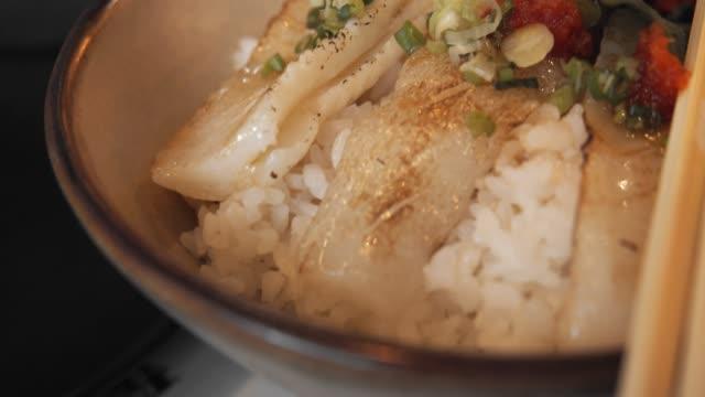 japan engawa fish don .fish above a japanese rice - donburi stock videos and b-roll footage
