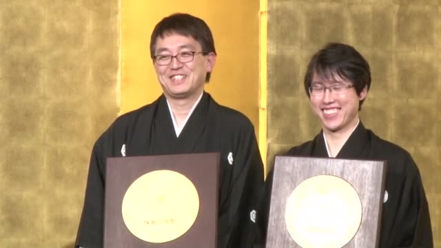 The government bestowed Tuesday the People's Honor Award on two champions of the Japanese traditional board games of shogi and Go making the two men...
