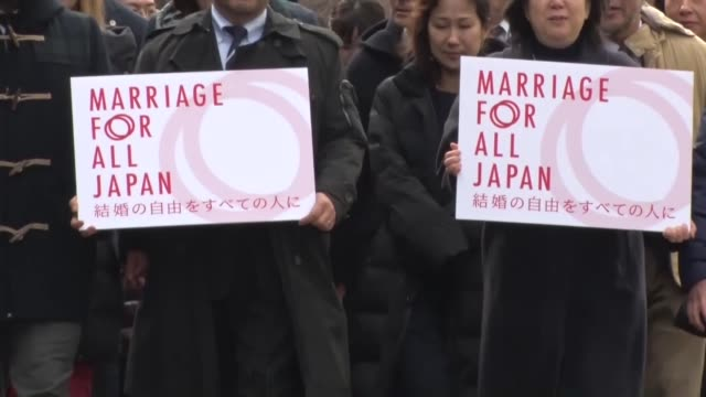 Samesex couples demanding marriage equality meet the press in front of Tokyo District Court on Feb 14 before filing lawsuits against the Japanese...
