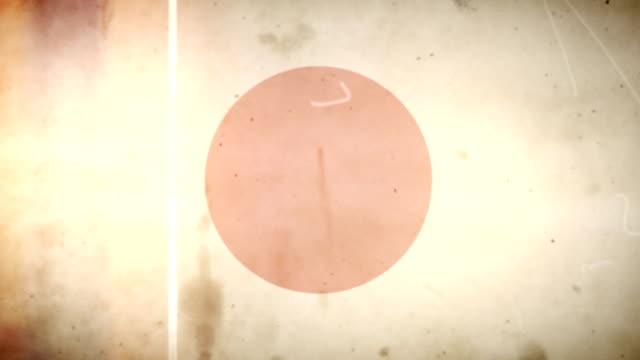 vídeos de stock e filmes b-roll de japão bandeira de grunge retro velho filme loop com áudio - fuga de luz