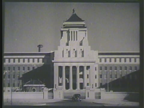 japan government building int vs general hideki tojo sitting at desk in office stamping various papers law making - 1930~1939年点の映像素材/bロール