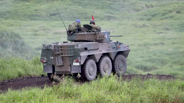japan ground selfdefense force battle tanks fire ammunition during a live fire exercise at the foot of mount fuji in the hataoka district of the east... - japan self defense forces stock videos and b-roll footage