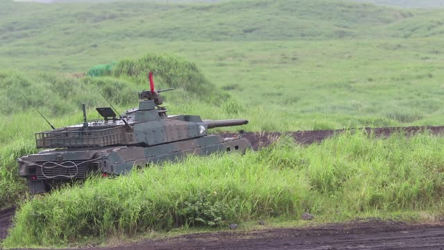 japan ground selfdefense force battle tanks move during a live fire exercise at the foot of mount fuji in the hataoka district of the east fuji... - japan self defense forces stock videos and b-roll footage