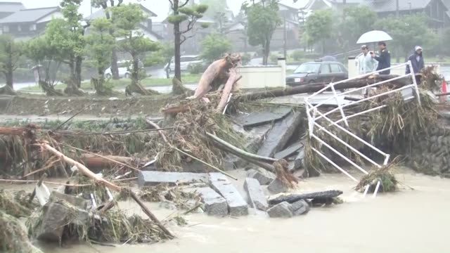 torrential rain hit the main island of kyushu in southwestern japan on wednesday causing river floods and mudslides and leaving at least 10 people in... - oita city stock videos & royalty-free footage