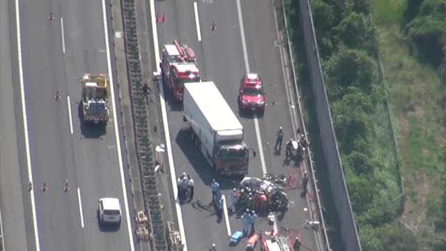 three people were killed thursday after a large truck collided with a car on an expressway in shiga prefecture western japan authorities said - traffic accident stock videos & royalty-free footage