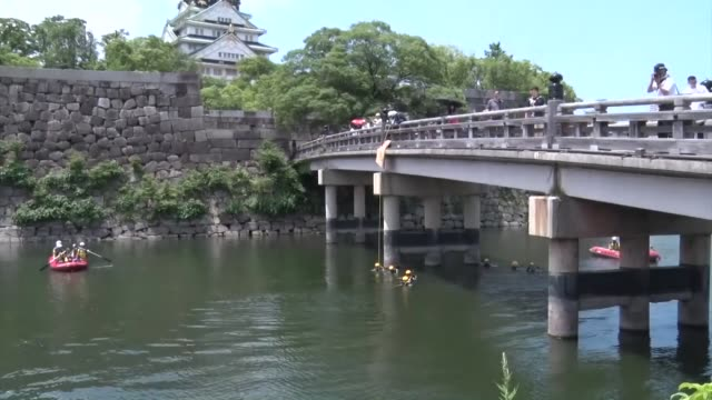 police officers inspect the moat of osaka castle on june 24 as security tightened ahead of the june 2829 group of 20 summit - moat stock videos & royalty-free footage
