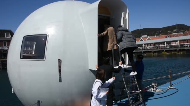 a futuristic floating capsule hotel was unveiled to the press tuesday ahead of its official launch at the huis ten bosch theme park in southwestern... - {{relatedsearchurl('capsule pipeline')}} stock videos and b-roll footage