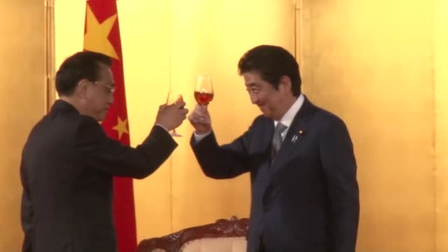 chinese premier li keqiang on thursday urged japan to join china's silk road infrastructure project saying its participation would likely contribute... - 金融と経済点の映像素材/bロール
