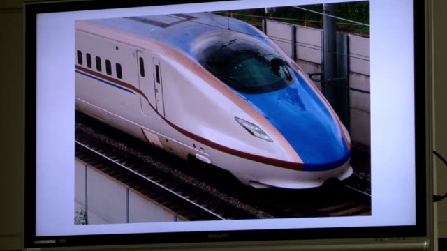 japan mint on friday january 30 started making 100-yen memorial coins to mark year's 50th anniversary of inauguration of shinkansen bullet train. at... - 式典点の映像素材/bロール