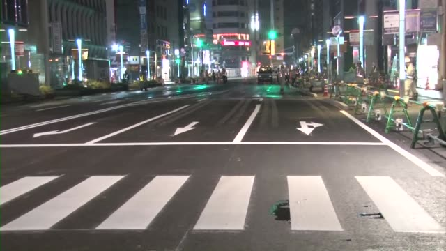 A road in front of JR Hakata station in the southwestern Japan city of Fukuoka reopens on Nov 15 after a huge sinkhole there was filled with soil The...